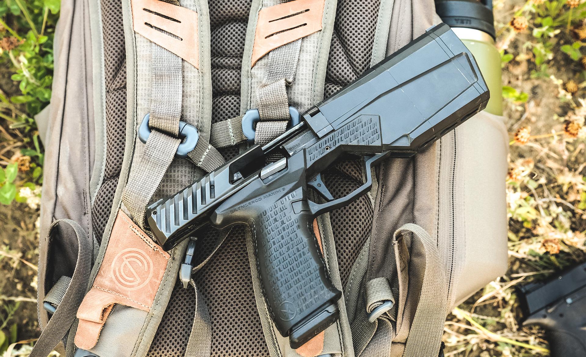 maxim 9mm handgun with integrated suppressor